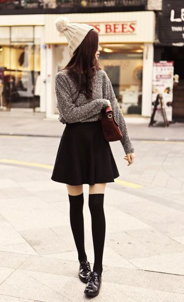 gray knitted sweater black skater skirt