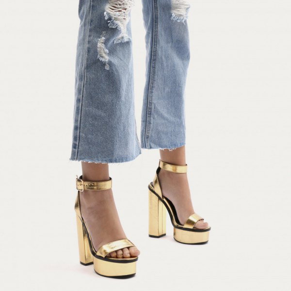 ripped flared jeans gold platform heels