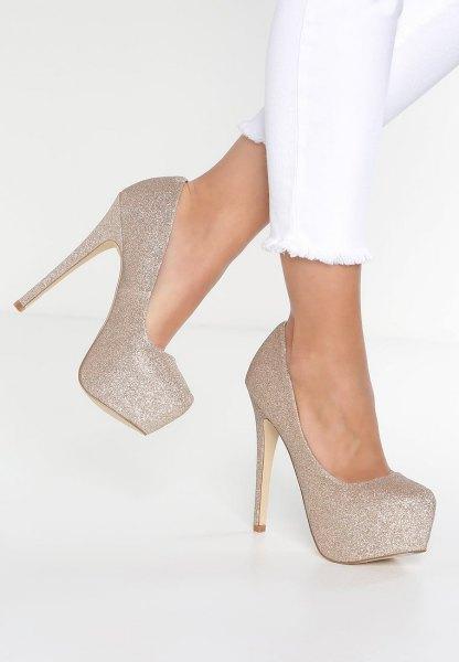 white skinny jeans gold rose platform heels