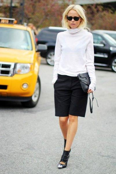 white turtleneck sweater black knee length shorts
