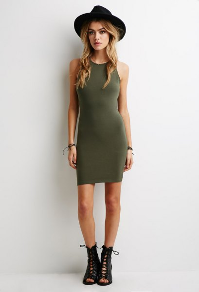 green dress black felt hat lace up boots