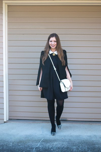 black dress blazer draped over the shoulders