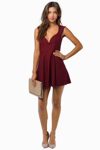 deep v-neck burgundy dress pink clutch bag