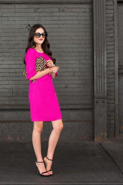 pink knee length dress cheetah clutch bag