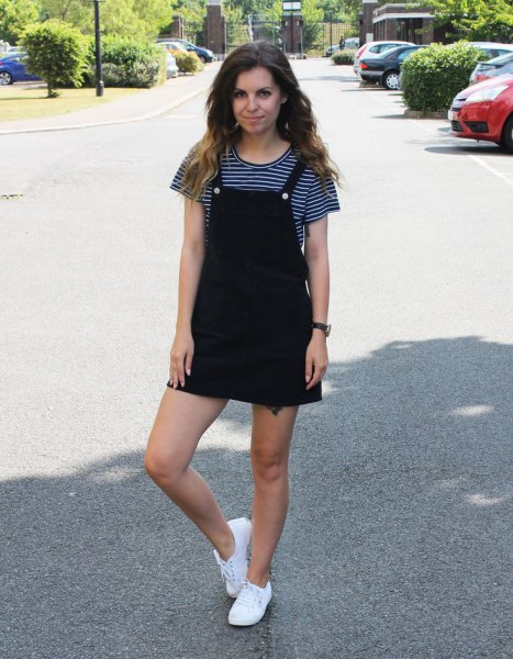 black pinafore dress black and striped t-shirt
