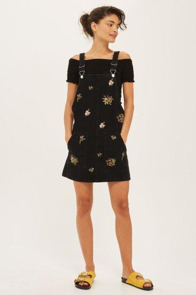 black floral pinafore dress off the shoulder