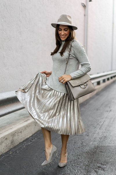 gray form fitting long sleeve tee silver skirt