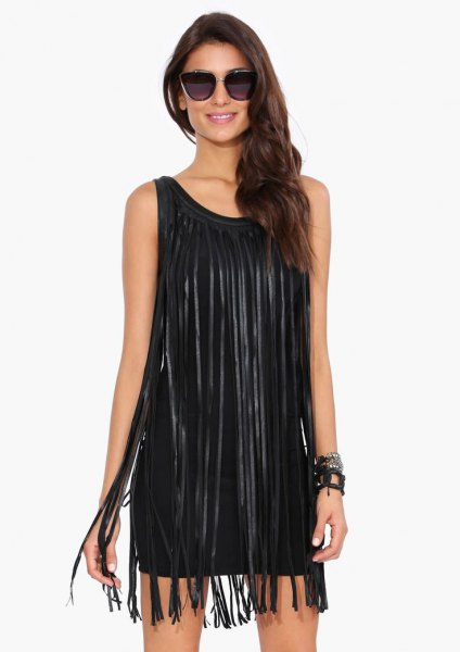 black sleeveless dress with long fringes
