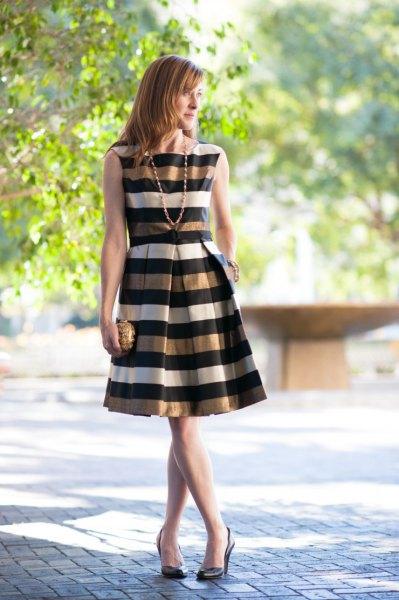 gold black white striped sleeveless flare dress