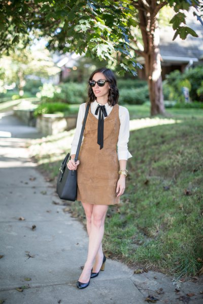 brown suede dress over white bow shirt