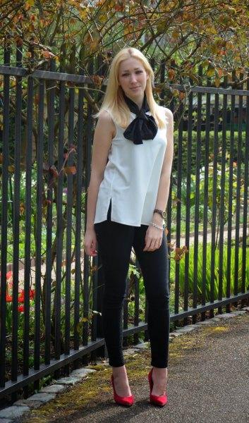 white sleeveless bow blue black skinny jeans