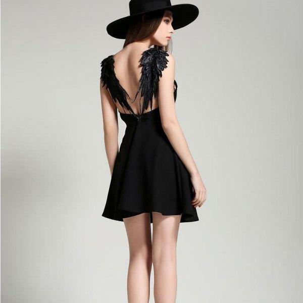 backless black skater dress with angel wings design