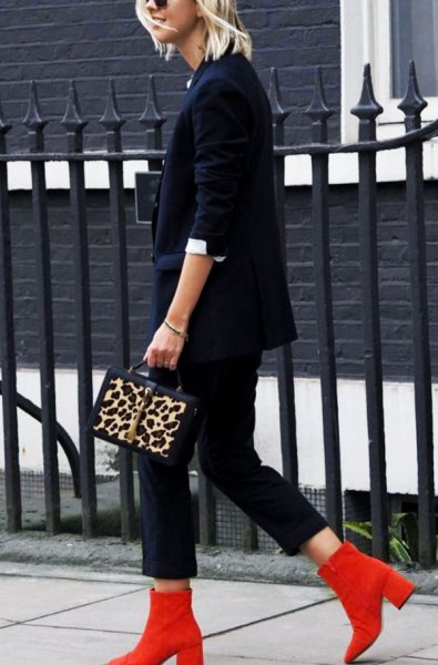 red boots navy suit cheetah handbag