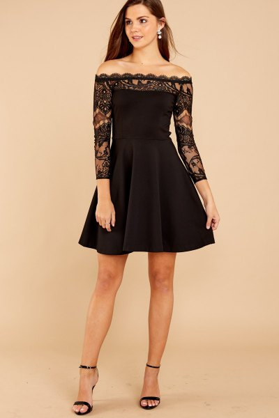 black lace in a long sleeve fit and flare dress