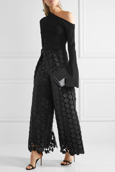 black lace trousers over one shoulder