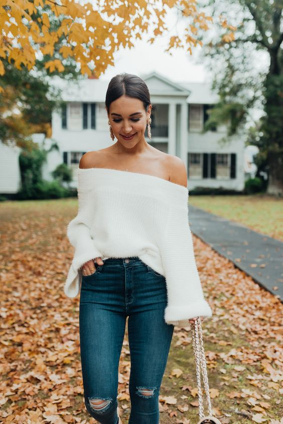 white fluffy sweater from the shoulder