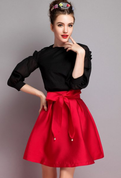 black knitted sweater red knotted flare skirt