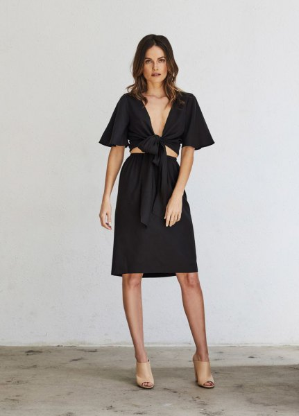cropped black wrap top knee length skirt