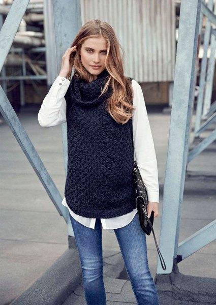 black sleeveless sweater white shirt slim jeans