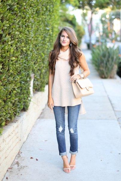 cream neck sleeveless sweater cuffed jeans