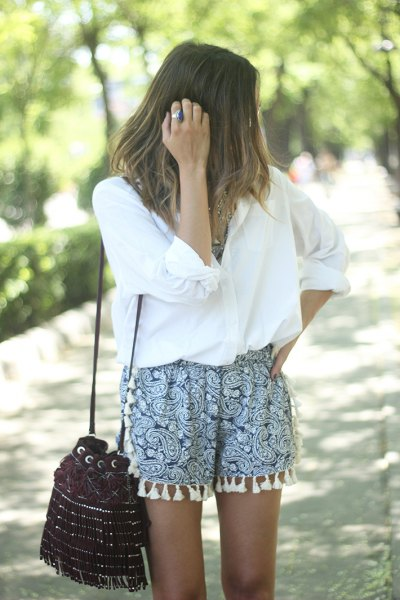 white oversized button up shirt printed shorts