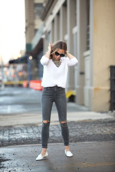 white v-neck knitted sweater gray ripped jeans