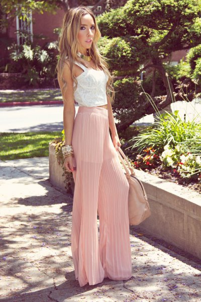 white lace vests top pink pleated trousers