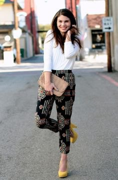 white long sleeve top black printed trousers