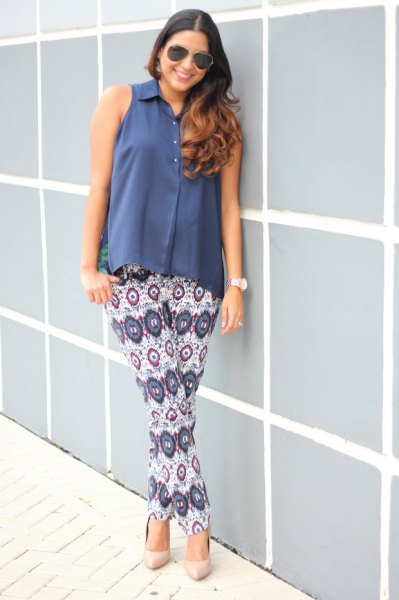 blue sleeveless button up blouse white tribal printed trousers