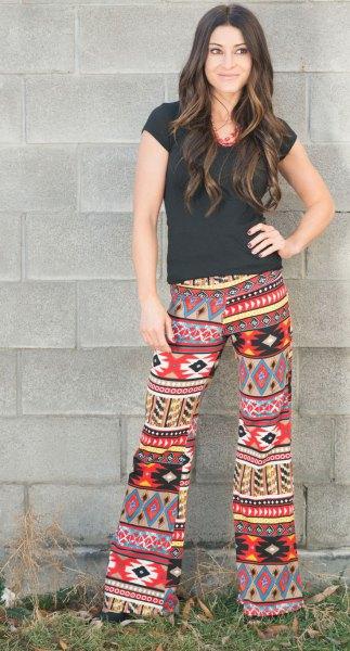 black t-shirt colorful tribal printed pants