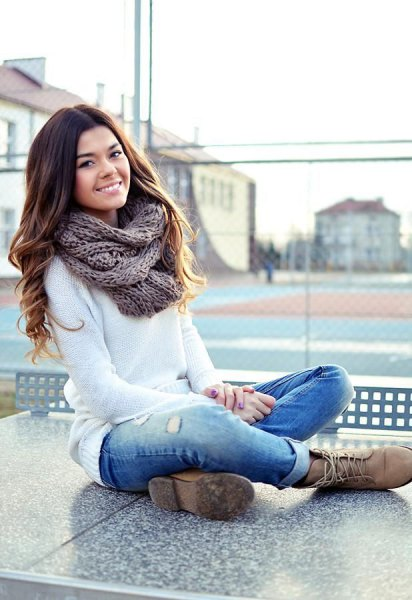 white knitted sweater cuffed jeans