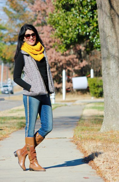 yellow scarf black sweater gray vest