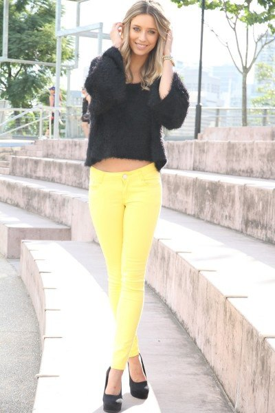 black cropped sweater yellow jeans
