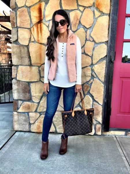 ivory vest over white upper ankle boots