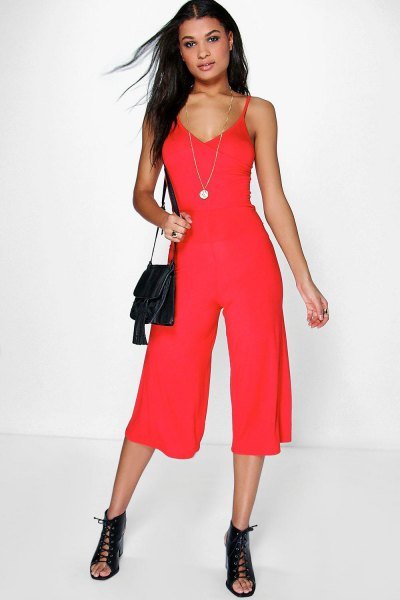 red deep v-neck jumpsuit open toe boots