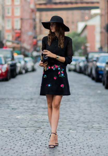 black sweater floppy hat embroidered skirt