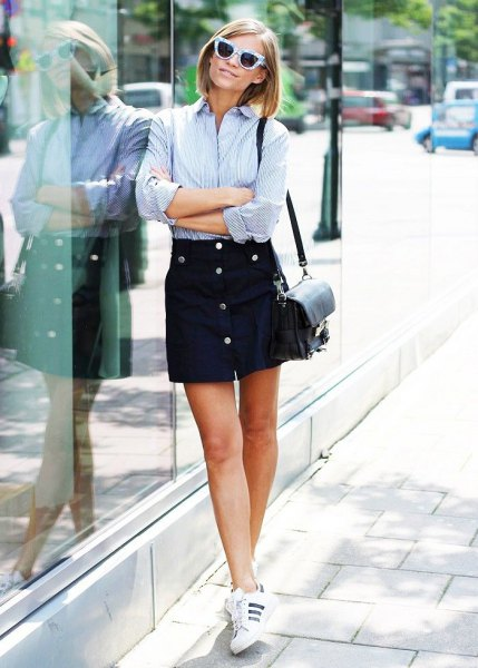 blue and white striped shirt with black button up skirt