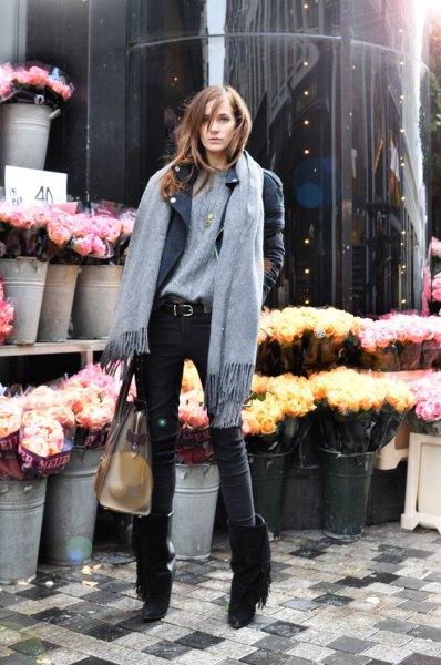 black fringed boots gray sweater leather jacket