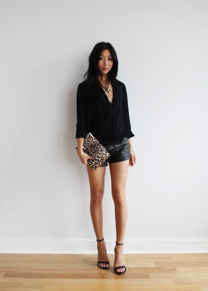 black v-neck blouse leather shorts