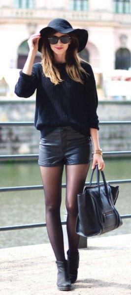 floppy hat black leather shorts