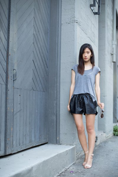 gray t-shirt black leather shorts