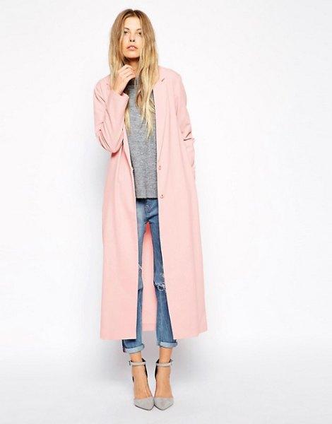 beige maxi jacket gray sweater cuffed jeans
