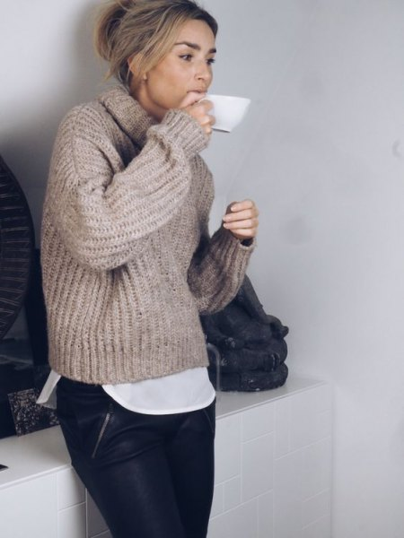gray chunky sweater with high neck and leather pants
