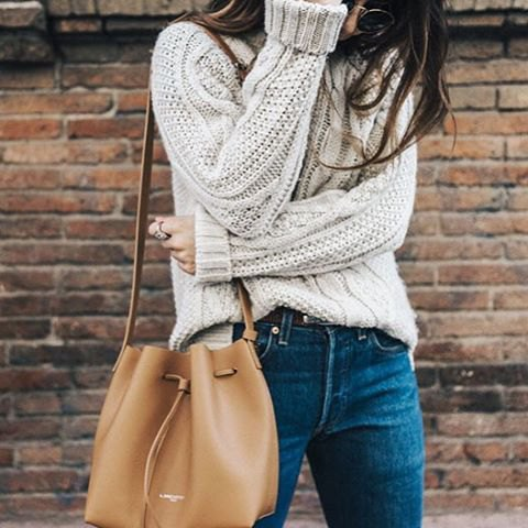 partially tucked into chunky sweater outfit