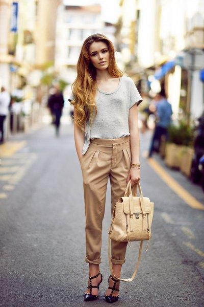 beige pants black strappy heels