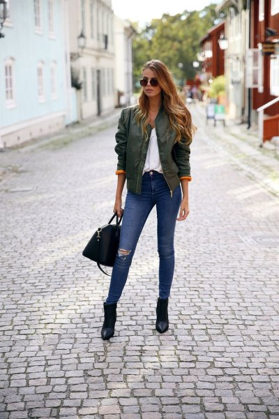 green bomber jacket with pointed toe boots