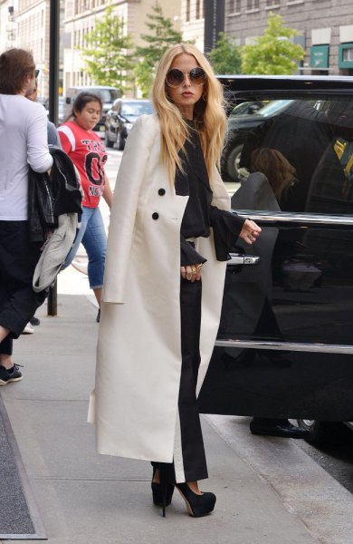 white maxi blazer draped over the shoulder