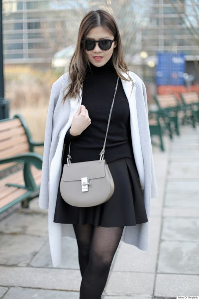 gray wool coat over shoulder black skater skirt