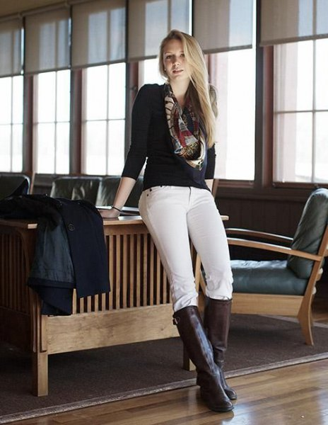 black sweater white riding breeches knee high boots