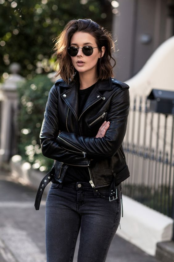 black leather moto jacket gray jeans